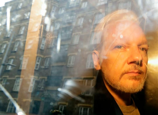 WikiLeaks founder Julian Assange is taken from court, where he appeared on charges of jumping British bail seven years ago, in London, Wednesday May 1, 2019. The United States has indicted Assange on more charges.