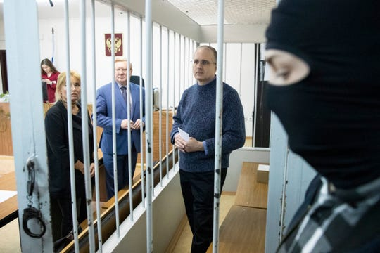 Paul Whelan, a former U.S. Marine, center, who was arrested in Moscow at the end of last year, waits for a hearing in a court in Moscow, Russia, Friday, May 24, 2019.