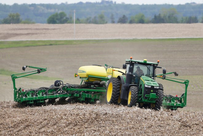A farmer plants soybeans in a field in Springfield, Neb., Thursday, May 23, 2019. President Donald Trump rolled out another $16 billion in aid for farmers hurt by his trade policies, and financial markets shook Thursday on the growing realization that the U.S. and China are far from settling a bitter, year-long trade dispute.