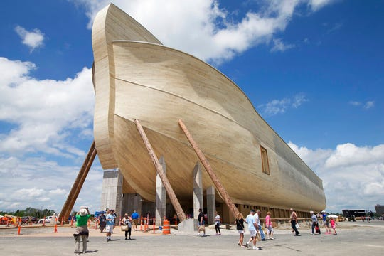 In this July 5, 2016, file photo, visitors pass outside the front of a replica Noah's Ark at the Ark Encounter theme park in Williamstown, Ky. In the Bible, the ark survived an epic flood. Yet the owners of Kentucky's Noah's ark attraction are demanding their insurance company rescue them from flooding that caused nearly $1 million in property damage.