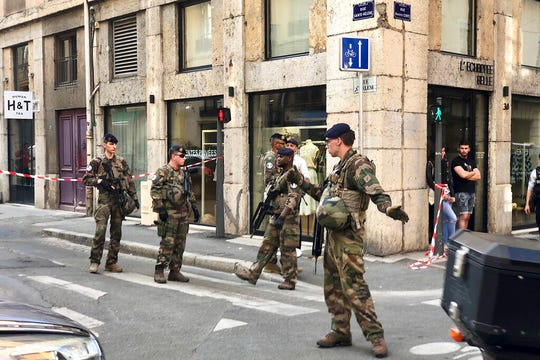 "Soldiers of French anti terrorist plan ""Vigipirate Mission"", secure the area near the site of a suspected bomb attack in central Lyon, Friday May, 24, 2019."