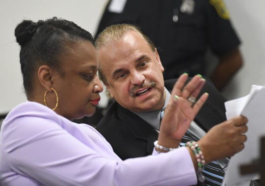 Robert Carmack speaks with his attorney Lillian Diallo Friday during his preliminary examination.