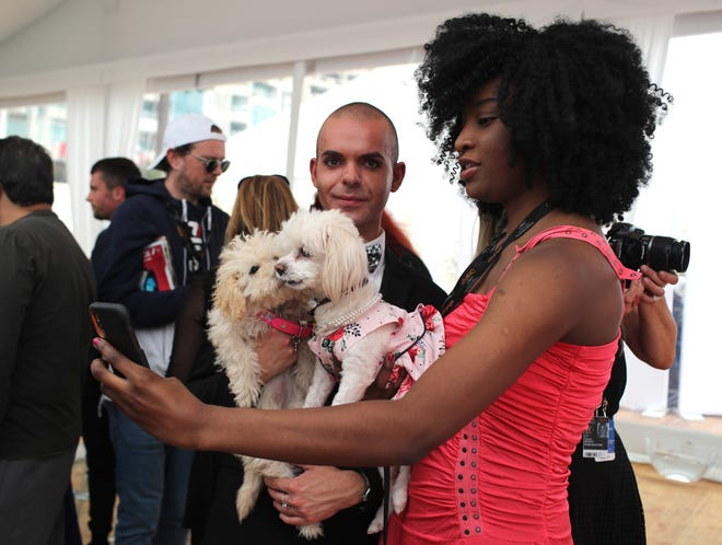Francesca and her Havanese dog, Skiddo, attend the photo call for the palm dog competition at Cannes.