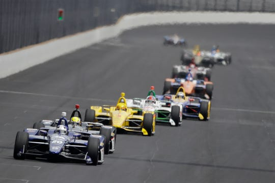 Ed Carpenter leads a group of cars into turn one during the final practice session for the Indianapolis 500 on Friday.