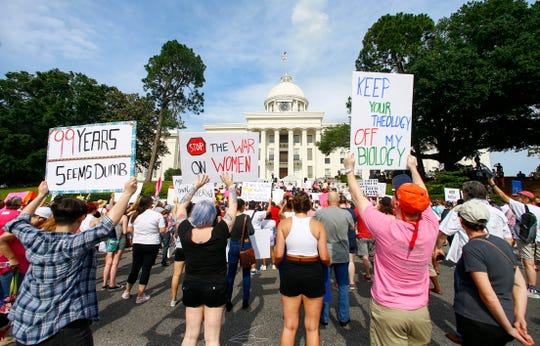 Protesters for women's rights hold a rally on the Alabama Capitol steps to protest a law passed last week making abortion a felony in nearly all cases with no exceptions for cases of rape or incest, Sunday, May 19, 2019, in Montgomery, Ala.