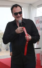 Director Quentin Tarantino speaks after winning the Palm Dog collar award for the dog Brandy that appeared in his film 'Once Upon a Time in Hollywood.'