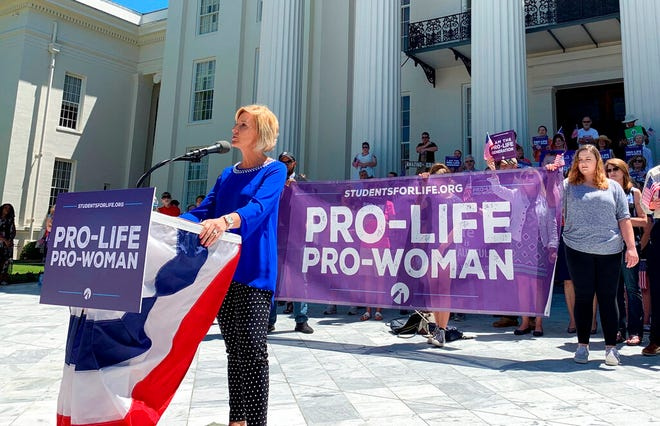 In this Wednesday, May 22, 2019, file photo, Beck Gerritson, president of Eagle Forum of Alabama, speaks at an anti-abortion rally outside the Capitol in Montgomery, Ala. Even as the anti-abortion movement celebrates passage of sweeping bans in several states, a rift is widening between activists who oppose exceptions for rape and incest, and other abortion opponents, including many Republican politicians, who support those exceptions.