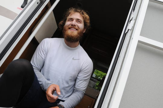 Mike Posner takes a break after a 7.5 mile trek during his walk across America.