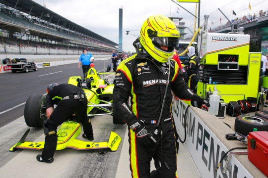 Simon Pagenaud walks away from his car after the final practice session for the Indianapolis 500 on Friday.