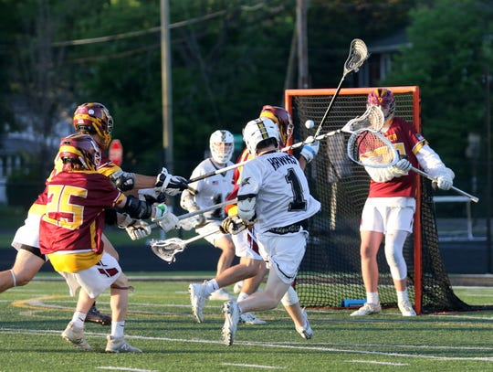 Corning's Seth Grottenthaler fires a shot into the net for a goal against Ithaca during the Section 4 Class A boys lacrosse final May 23, 2019 at Corning Memorial Stadium.