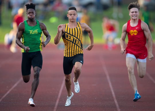 Central's Jalen Bowman, center, cruises to first place in the Boys 100 Meter Dash against Floyd Central's Jon Gunn, left, and Mater Dei's Dakx Lannert at the Boys Track & Field Regional at Central Stadium Thursday evening. Bowman also won the 200 Meter Dash and was the anchor of the first place 4x100 Meter Relay team.