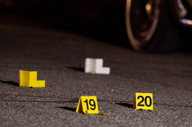 Evidence markers are placed throughout the 1200 block of Madison Avenue on Evansville's South Side after a shooting the sent one to the hospital Thursday, May 23, 2019.