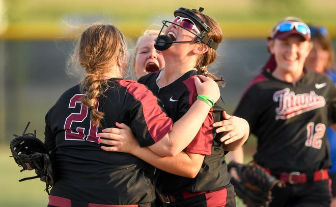 Gibson Southern pitcher Lyndsi Adamson (3) is congratulated by teammates after defeating Castle with a one hitter as the Gibson Southern Titans play the Castle Knights in the Girls Softball Class 4A Sectionals played at North High School Thursday, May 23, 2019.