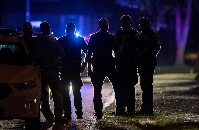 Police gather in the 1200 block of Madison Avenue on Evansville's South Side after a shooting that sent one to the hospital Thursday, May 23, 2019.