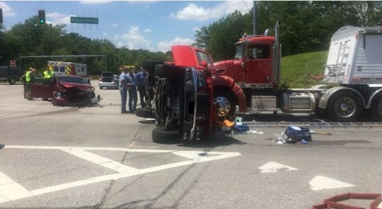The crash scene at the corner of Diamond Avenue and Big Cynthiana Road on Friday afternoon. Three were sent to the hospital.