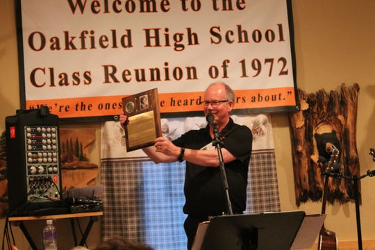 Jim Kiser spent countless hours researching Peter Williams' success to present him a plaque at the 47th reunion of the Oakfield Class of 1972