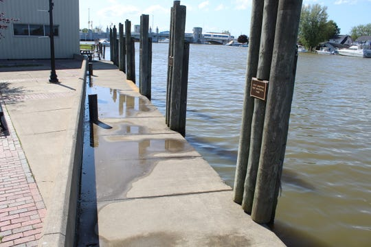 Northeast winds and record-high Lake Erie levels have pushed water up over docks and walkways by the Portage River in downtown Port Clinton and flooded streets several times this year. The latest flooding occurred Wednesday morning, with water receding by the afternoon.
