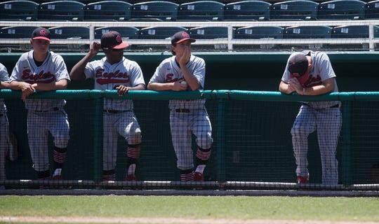 Members of the North Florida Christian School baseball team sit dejected after losing to the Canterbry Baseball team at Hammond Stadium in Fort Myers on Friday.