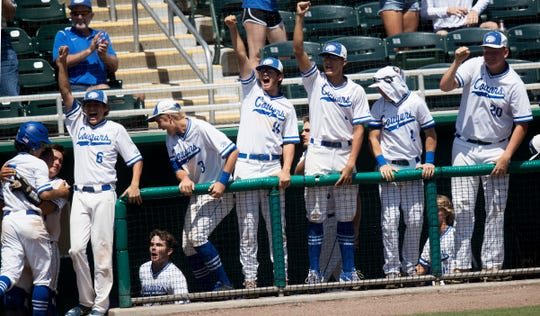 Members of the Canterbury baseball team react to a scored run against North Florida Christian School at Hammond Stadium on Friday. The team moved on to a state final game on Saturday.
