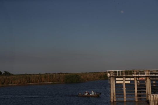 Fishermen use Lake Okeechobee in Clewiston on Thursday May 16, 2019. FILE