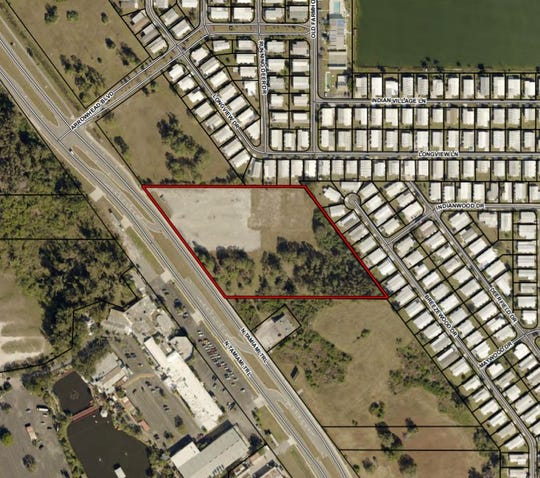 Site of planned 80,000 square foot boat and RV storage facility on North Fort Myers. The property borders residential neighborhoods to the north and east and at the recommendation of the county hearing examiner, no entrance to the facility will be permitted from the sides bordering neighborhoods.