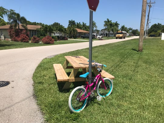 A bench sits at the school bus stop in Hetherington's neighborhood in Cape Coral, remnants of the movement started by Layla Aiken's hit-and-run death.
