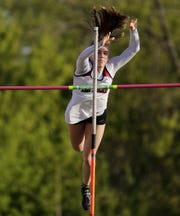 De Pere's Olivia Fabry clears the bar in pole vault competition at a Division 1 WIAA track sectional meet on Thursday.