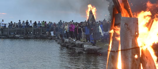 "Bonfires along the Eagle Harbor shoreline in Ephraim symbolize the burning of the ""winter witch'' and the arrival of summer during the annual Fyr Bal festival."