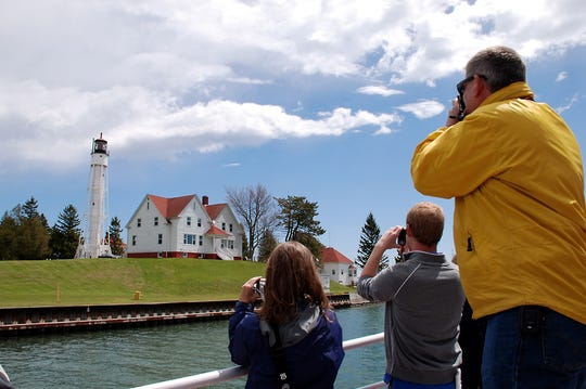 The Sturgeon Bay Canal Light, operated by the US Coast Guard, gets attention from photographers during a previous Door County Lighthouse Festival.