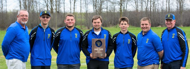 The Oconto High School boys golf team won the Regional Championship at Thornberry Creek Golf Course in Hobart on Tuesday, May 21. Posing with the regional title plaque are, from left, coach Russ Young, Josh Delzer, Collin Ebben, Andrew Westphal, Will Sherman, Noah Young, and head coach Jeff Werner