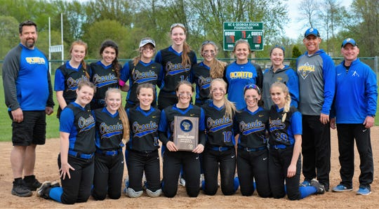 The Oconto High School softball team pose with their Division 3 Regional Championship plaque on Thursday. From left, front row, Kalista Susa, Maycie Phillips, Hallie Wusterbarth, Nevaeh Brill, Hannah Wusterbarth, Morgan Durand, Leah Allan; back row assistant coach Jeff Berth, McKenna Seidl, Juliana Sieber, Maggie Sohrweide, Mara Allen, Ellen Sohrweide, MacKenzie Honish, Morgan Ratajczyk, assistant  coach Brian Sohrweide, head coach Jeremy Wusterbarth.