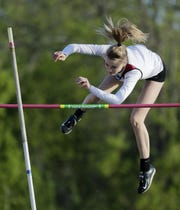 De Pere's Grace Kowalkowski clears the bar in pole vault at a Division 1 WIAA track sectional meet on Thursday.