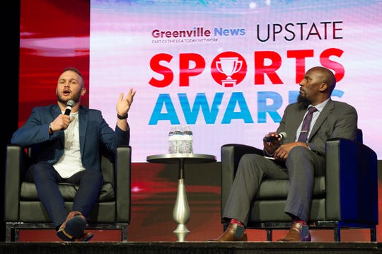 Manie Robinson (right) talks with speaker Ben Boulware at the Greenville News Upstate Sports Awards held at the Greenville Convention Center Thursday, May 23, 2019.