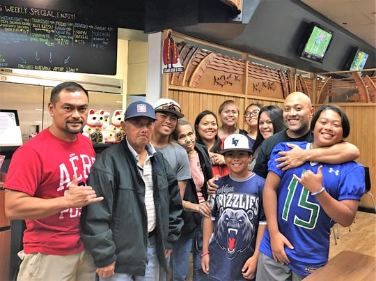 Jathan Sibal, wearing a gray T-shirt, gets together with family and friends at a local Las Vegas restaurant.