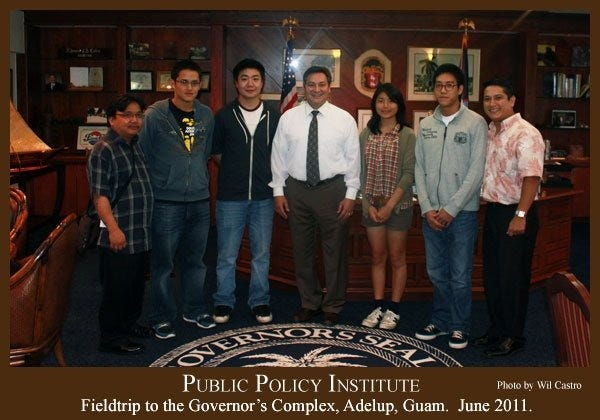 Public Policy Institute interns pose with Gov. Eddie Calvo in 2011.