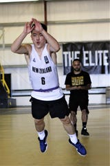 In this file photo, Michael Min works on an explosion drill with coach Dom Sablan during a private training session with Guam Elite Basketball.