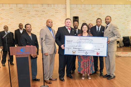 Pictured: Jerome Lipsomb Consistory#110 donated $500 to the Junior Achievers.