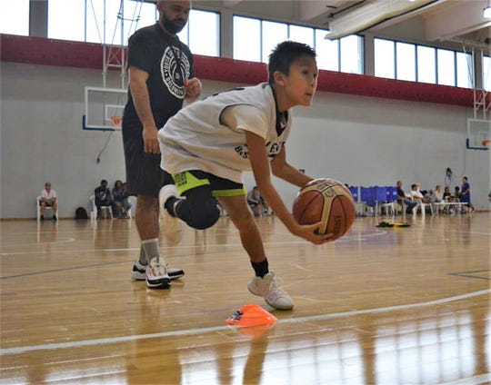 Under the watchful eye of Dom Sablan, middle school player Gavin Boyd demonstrates triple-threat action. Guam Elite Basketball has announced the dates for its popular summer basketball camps.