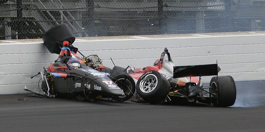 Indy Lights driver David Malukus (79) slams into Chris Windom (17) during the Freedom 100 race at the Indianapolis Motor Speedway on Friday.