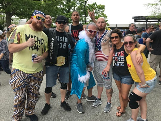 A group of friends and family dressed along a pro wrestling theme on Carb Day, May 24, 2019. From left, Tony Root as Macho Man, Colin Hester as Scott Hall, Rob Wathen as Steve Austin, Brandyn Hester as Kevin Nash, David Root as Ric Flair, Justin Turnbaugh as Kurt Angle, Morgan Suding as herself and Cat Root as Hulk Hogan.
