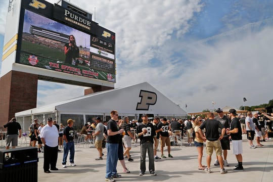 Fans enjoy cold drinks, including craft beer, in the newly redesigned south end zone prior to the Boilermakers game against Western Michigan, August 30, 2014, at Ross-Ade Stadium.