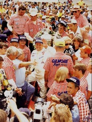 A. J. Foyt celebrated in Victory Circle after his fourth Indy 500 win at the Speedway in 1977.
