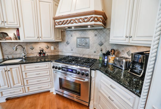 A custom home features an open plan kitchen with six burner gas stove at 4884 E. Krestridge Court, Bargersville, Ind. 46106, on Wednesday, May 23, 2019.