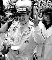 A.J. Foyt holds up four fingers in Victory Lane after winning his fourth Indianapolis 500 auto race at Indianapolis Motor Speedway in Indianapolis in 1977. Foyt also won the Indy 500 auto race in 1961, 1964, 1967.
