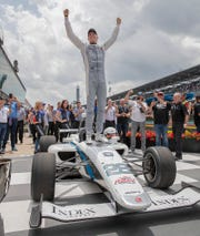 Oliver Askew, of Andretti Autosport, celebrates his win in the Freedom 100 Indy Lights race during Carb Day at the Indianapolis Motor Speedway on Friday, May 24, 2019.