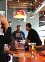 Jailbird owner Josh Gonzales talks to first-day customers at his new Southside bar and grill. Jailbird opened May 23, 2019, at 4022 Shelby St., near University of Indianapolis.