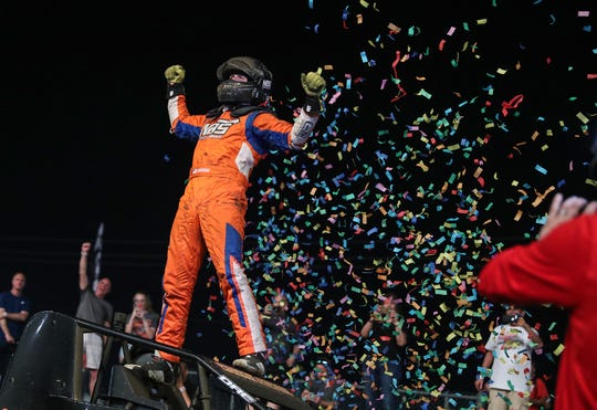 Tyler Courtney (97), of Indianapolis, celebrates after winning the 64th running of the Hoosier Hundred at the Indiana State Fairgrounds in Indianapolis on Thursday, May 23, 2019. Courtney passed driver Kevin Thomas Jr. after a restart with 8 laps to go to clinch the victory.