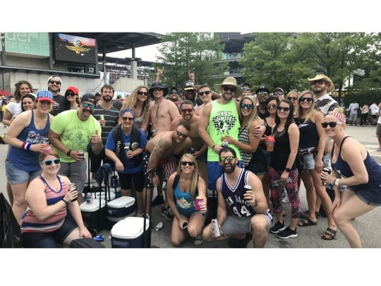 "More than 25 ""Noodle Gang"" members celebrate Carb Day on Pagoda Plaza."