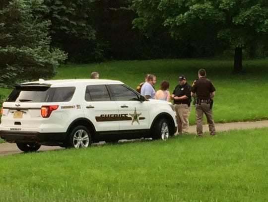 Officers question suspects after raid of Owen and Morgan County properties as part of animal fighting investigation.