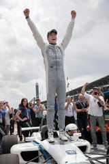 Oliver Askew, a former Andretti Autosport Indy Lights driver, celebrates his win in the Freedom 100 race during Carb Day at the Indianapolis Motor Speedway on Friday, May 24, 2019.